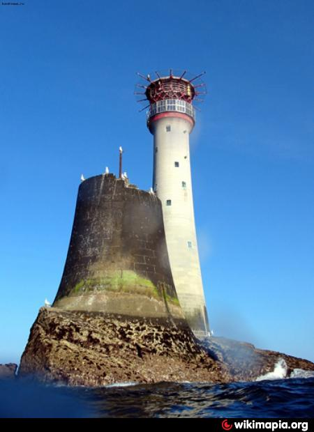 The stump of Smeaton's tower, with its replacement lighthouse in the background